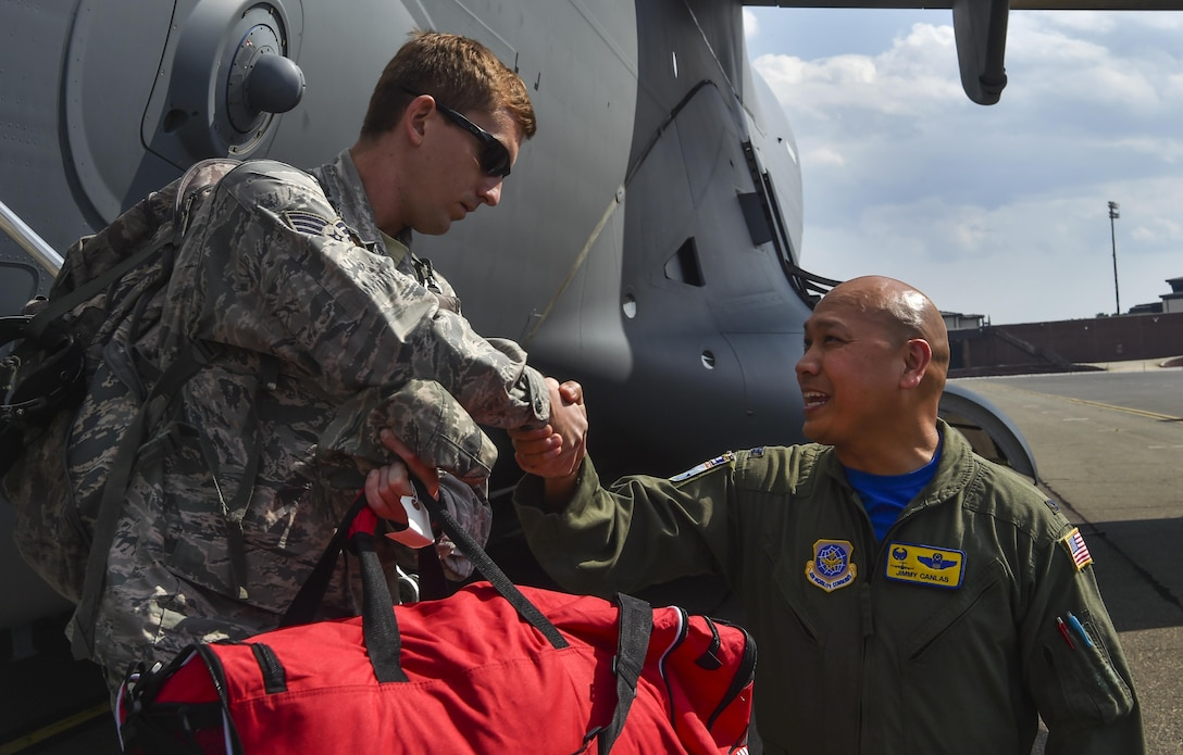 Col. Jimmy Canlas, 437th Airlift Wing commander, welcomes home Airmen of the 437th AW returning with the final evacuated C-17 Globemaster III Sept. 15, 2017 due to Hurricane Irma's potential landfall here. Twenty-two C-17s were evacuated to alternate locations and eight were diverted in response to the hurricane. Airmen of the 437th Aircraft Maintenance Squadron ensured the relocated aircraft were maintained and prepared to conduct hurricane recovery operations to the south from alternate installations including Scott Air Force Base, Ill.