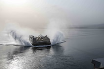 GULF OF ADEN (Sept. 4, 2017) – A Landing Craft Air Cushion approaches USS San Diego (LPD 22) during exercise Alligator Dagger 2017. The MEU-ARG team is deployed as a crisis response and contingency force prepared to conduct operations and partner nation training. Alligator Dagger is a dedicated, unilateral combat rehearsal led by Naval Amphibious Force, Task Force 51/5th Marine Expeditionary Brigade, in which combined Navy and Marine Corps units of the America Amphibious Ready Group and embarked 15th Marine Expeditionary Unit are to practice, rehearse and exercise integrated capabilities that are available to U.S. Central Command both afloat and ashore. (U.S. Marine Corps photo by Lance Cpl. Jeremy Laboy)