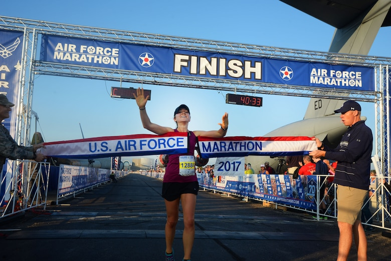 Molly Brown crosses the finish line as the overall women's winner of the 10K race at the 21st running of the 2017 U.S. Air Force Marathon at Wright-Patterson Air Force Base on Sept. 16.  Brown, from Grove City, Ohio, finished with a time of 33:04.  (U.S. Air Force photo / R.J. Oriez)