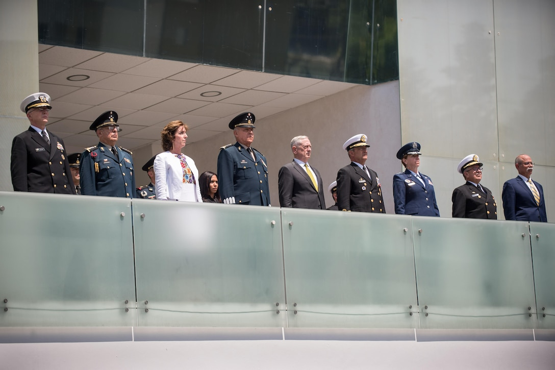 U.S. and Mexican defense leaders stand on a balcony.
