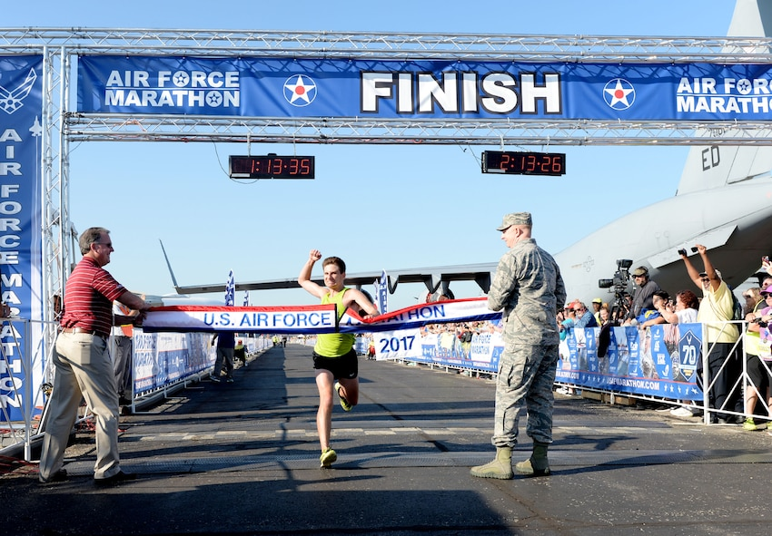 Jason Salyer crosses the finish line as the overall men's winner of the half maarathon at the 21st running of the 2017 U.S. Air Force Marathon at Wright-Patterson Air Force Base on Sept. 16. Salyer, from Columbus, Ohio, finished with a time of 1:13:34. (U.S. Air Force photo / Wesley Farnsworth)