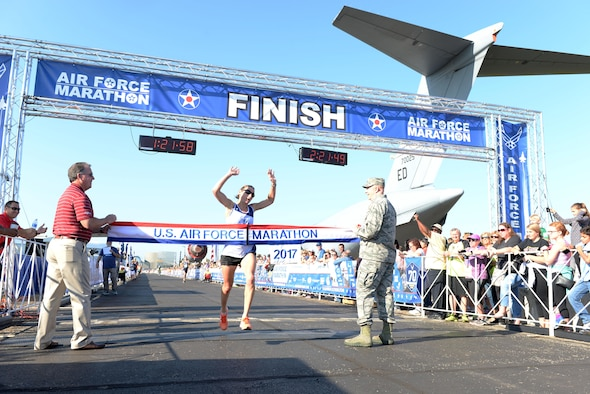 Tech. Sgt. Emily Shertzer crosses the finish line as the overall women's winner of the half marathon at the 21st running of the 2017 U.S. Air Force Marathon at Wright-Patterson Air Force Base on Sept. 16. Shertzer, from Jonestown, Pennsylvania, finished with a time of 1:21:56. (U.S. Air Force photo / Wesley Farnsworth)