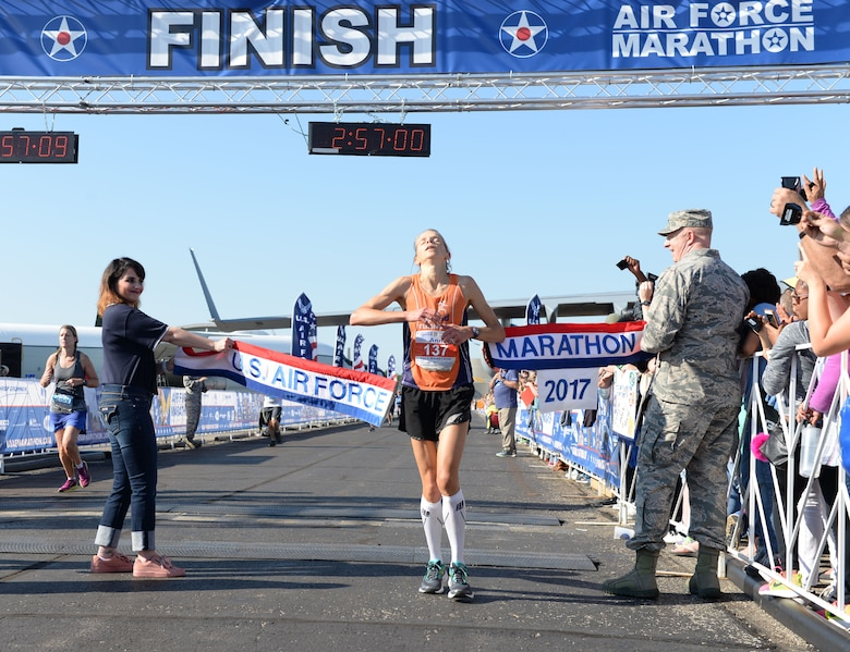 Ann Alyanak crosses the finish line as the overall women's winner of the full marathon at the 21st running of the 2017 U.S. Air Force Marathon at Wright-Patterson Air Force Base on Sept. 16. Alyanak, from Bellbrook, Ohio, finished with a time of 2:56:57. (U.S. Air Force photo / Wesley Farnsworth)