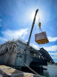 Civil service mariners assigned to Military Sealift Command load pallets onto USNS Spearhead (T-EPF 1) at Naval Station Guantanamo Bay.