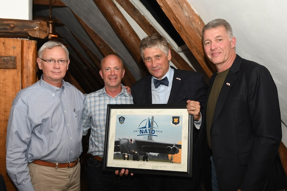 Ivo Vondrak (center right), governor of the Moravian-Silesian Region of the Czech Republic, is presented a photo of a B-52 Stratofortress by Brig. Gen. Jonathan Ellis (center left), the mobilization assistant to the 8th Air Force Commander, Col. Robert VanHoy (left), the 307th Bomb Wing commander, and retired Col. Joe Jones (right), a sister city representative from Shreveport, La., during the Jagello 2000 Welcome Dinner at the Zábřeh Castle September 14, 2017 in Ostrava, Czech Republic.