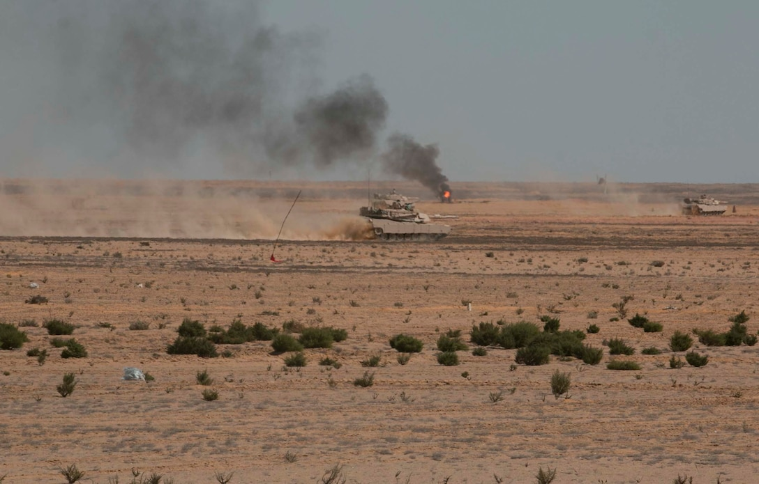 Egyptian M1A1 Abrams Main Battle Tanks maneuver through their lanes while previously engaged targets smolder in the background during the culminating combined arms live-fire exercise of Exercise Bright Star 2017 in Mohamed Naguib Military Base, Egypt, Sept. 16. The exercise allows the U.S. military the chance to sustain readiness while strengthening partnership and promoting interoperability. (U.S. Army photo by Staff Sgt. Leah R. Kilpatrick)