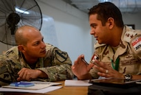 A U.S. Army Soldier from the 2nd Battalion, 7th Cavalry Regiment, 3rd Armored Combat Team, 1st Cavalry Division, speaks with an Egyptian solider during a command-post exercise portion of Bright Star 2017, Sept. 15, 2017, at Mohamed Naguib Military Base, Egypt. More than 200 U.S. service members are participating alongside the Egyptian armed forces for the bilateral U.S. Central Command Exercise Bright Star 2017, Sept. 10 - 20, 2017 at Mohamed Naguib Military Base, Egypt. (U.S. Air Force photo by Staff Sgt. Michael Battles)