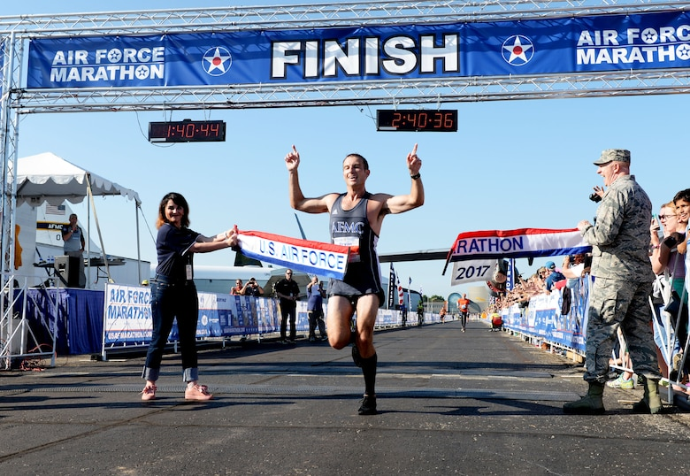 Maj. Bryan Kelly, Air Force Materiel Command test pilot from Edwards Air Force Base, California, crosses the finish line as the overall men's winner of the full marathon at the 21st running of the 2017 U.S. Air Force Marathon at Wright-Patterson Air Force Base on Sept. 16. Kelly, from Edwards, California, finished with a time of 2:30:34. (U.S. Air Force photo / Wesley Farnsworth)