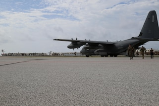 Hurricane relief personnel, including service members with Joint Task Force - Leeward Islands, disembark from a U.S. Air Force C-130 at Princess Juliana International Airport in Sint Maarten, Sept. 15, 2017.