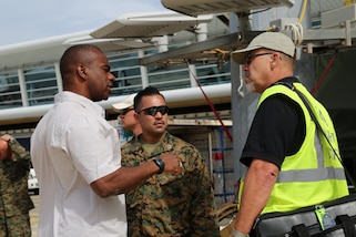 U.S. service members with Joint Task Force - Leeward Islands speak with a Federal Aviation Administration airport inspector at Princess Juliana International Airport in Saint Maarten, Sept. 15, 2017.