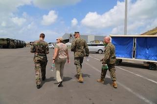 A French military leader walks with Anne Galegor, a representative of USAID, U.S. Marine Col. Michael V. Samarov, and Sgt. Maj. Glenn D. Bragg, the JTF-LI sergeant major, at the Grand Case Airport in Saint Martin