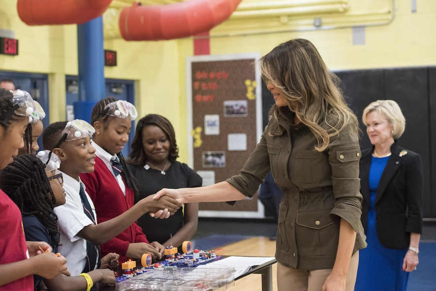 Melania Trump shakes hands with boy at the youth center