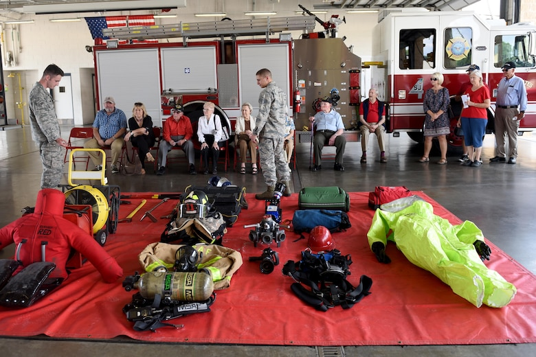 Members of the 4th Civil Engineering Squadron fire department present and explain the different pieces of equipment throughout a fire department, during the 4th Fighter Wing 75th Anniversary Tour, Sept. 15,2017, at Seymour Johnson Air Force Base, North Carolina. The tour also consisted of a readiness stop, which allowed spectators to experience the training the pilots go through when preparing to conduct overseas contingency operations through a simulator. (U.S. Air Force photo by Airman 1st Class Miranda A. Loera)