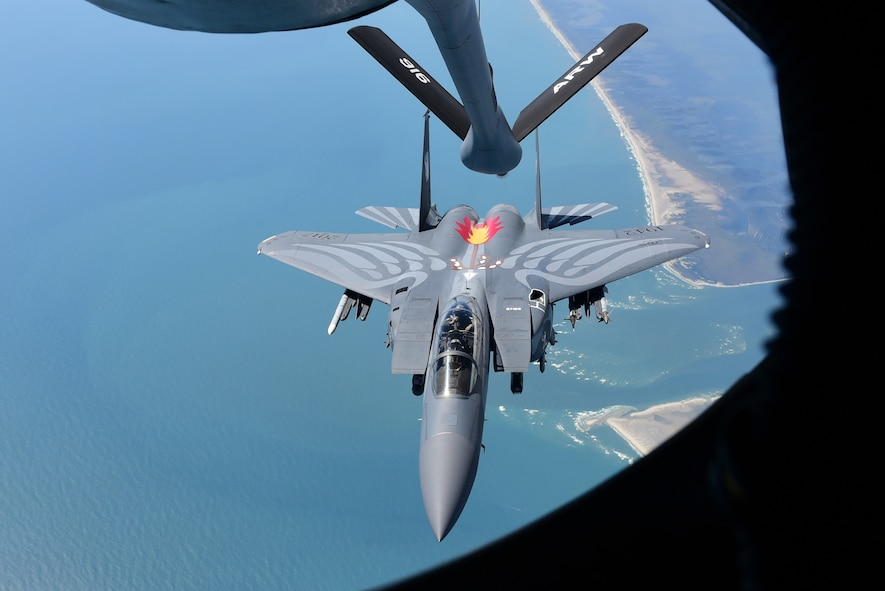 A 4th Fighter Wing F-15E Strike Eagle heritage paint scheme aircraft disconnects after refueling from a 916th Air Refueling Wing KC-135R Stratotanker, Sept. 14, 2017, in the skies above North Carolina.
