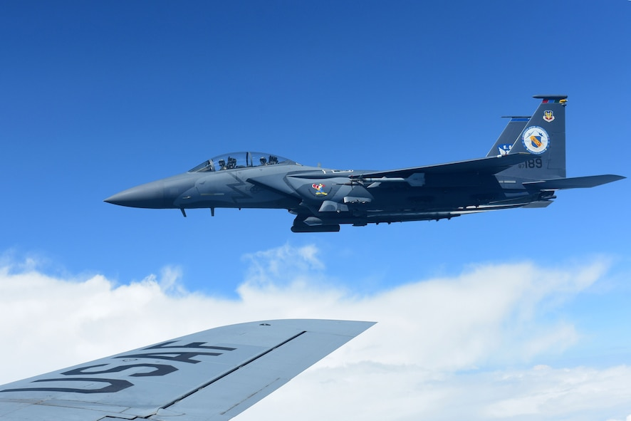 A 4th Fighter Wing F-15E Strike Eagle heritage paint scheme aircraft flies next to a KC-135R Stratotanker, Sept. 14, 2017, in the skies above the North Carolina coastline.