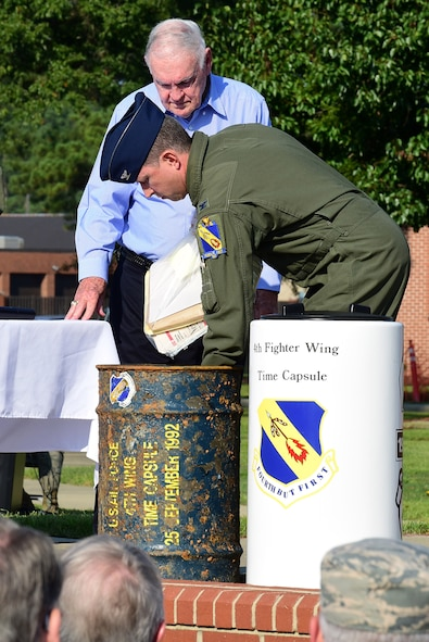 Col. Christopher Sage, 4th Fighter Wing commander, unveils the contents of a time capsule buried in 1992 with Bob Hill, Sept. 15, 2017, at Seymour Johnson Air Force Base, North Carolina. Hill attended the initial burial in 1967 and previous burial of the time capsule in 1992. (U.S. Air Force photo by Airman 1st Class Kenneth Boyton)