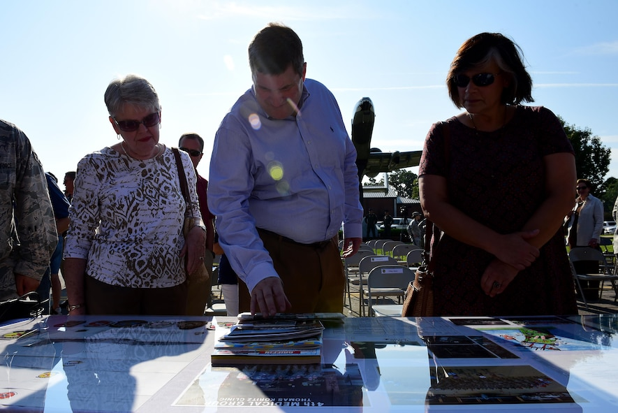 Members from Team Seymour and Goldsboro look at new items to be added to the new time capsule, Sept. 15, 2017, at Seymour Johnson Air Force Base, North Carolina. The contents from the 1992 capsule will be in the new capsule, along with digitized copies of some items too fragile to be buried for another 25 years. (U.S. Air Force photo by Airman 1st Class Kenneth Boyton)