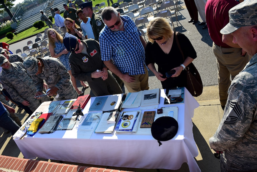 The audience and members from Team Seymour view the contents of the 1992 time capsule, Sept. 15, 2017, at Seymour Johnson Air Force Base, North Carolina. Some of the items included a copy of the local newspaper, 334th Fighter Squadron shirt, photos and a small F-4 Phantom II static. (U.S. Air Force photo by Airman 1st Class Kenneth Boyton)