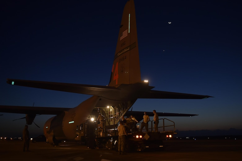 Aerial porters load cargo onto a C-130 Hercules aircraft at Homestead Air Reserve Base, Fla, Sep. 17, 2017.  The aircraft redeployed personnel and equipment from the Wisconsin National Guard back to their home station. The team had deployed to Florida in support of Hurricane Irma relief efforts. (U.S. Air Force photo by Tech. Sgt. Liliana Moreno/Released)