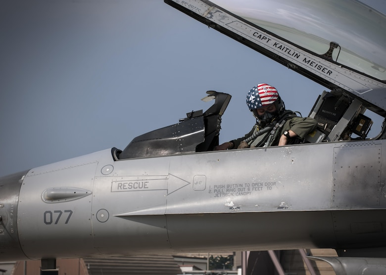 """U.S. Air Force Capt. Kaitlin Meiser, 8th Fighter Wing F-16 Fighting Falcon pilot, straps into her assigned aircraft during the """"Job Swap"""" event at Kunsan Air Base, Republic of Korea, Sept. 12, 2017. The week-long event was to give 8th SFS defenders a better look at the assets that they are protecting day in and day out. (U.S. Air Force photo by Staff Sgt. Victoria H. Taylor)"""