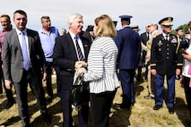 Honorable Kyle Scott, U.S. Ambassador to Serbia, and Xenia Wilkinson, daughter of U.S. intelligence officer George Vujnovich, talk after the Operation Halyard commemoration ceremony in Pranjani, Serbia, Sept. 16, 2017.