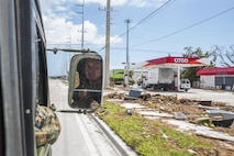Lance Cpl. Trenton Laake, a heavy equipment mechanic with Marine Wing Support Squadron 473, 4th Marine Aircraft Wing, Marine Forces Reserve, looks out of a Humvee as it drives through the streets of Marathon, Fla.