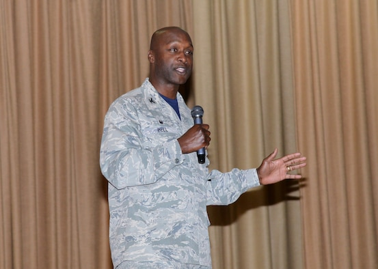 Col. Kenyon Bell, 72nd Air Base Wing commander, speaks during the Still In The Fight  luncheon Sept. 8 at the base theater.