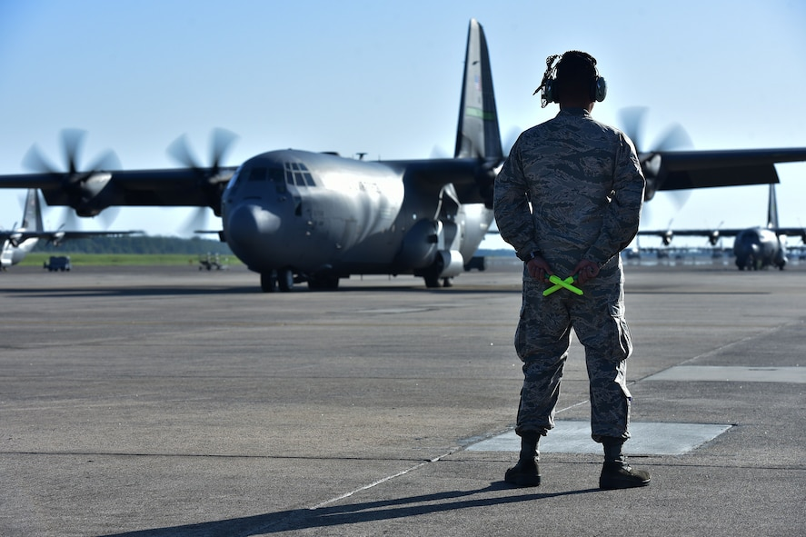 Airman 1st Class Omar Campos, 19th Airlift Maintenance Squadron crew chief, readies himself to marshal a C-130J taking members of Team Little Rock on the first leg of their trip to a deployment, at Little Rock Air Force Base, Ark. (U.S. Air Force photo by Airman Rhett Isbell)