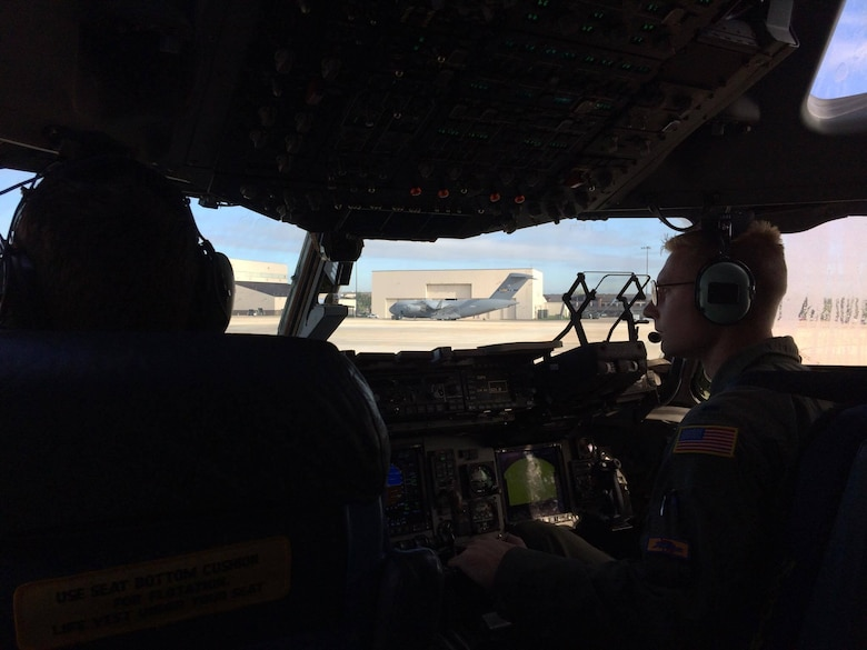 Capt. Evan Allen, 6th Airlift Squadron, prepares to take off with his C-17 crew from Joint Base McGuire-Dix-Lakehurst, N.J., Oct. 6, 2016 in response to Hurricane Matthew. The crew delivered the Joint Task Force-Port Opening team that establish the aerial port in Haiti allowing for 600,000 lbs. of relief supplies. The AMC aircrew was recognized with the 2016 Berlin Airlift Veterans Association Award Sept. 18, 2017 at the Air Force Association Convention in National Harbor, Md. (U.S. Air Force photo by Capt. Gary Rogers)