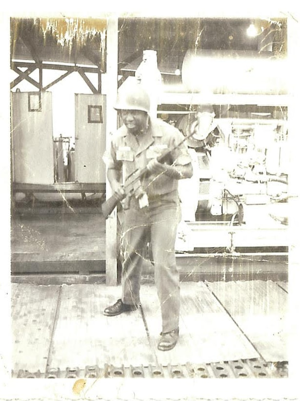 Retired Tech. Sgt. Lenard Ellison poses with his weapon in Saigon, Vietnam circa 1968.  Ellison, the patriarch of his family, began a family tradition of serving in the Air Force that continues today. Since 1947, there has been an Ellison in the Air Force. (Courtesy photo)