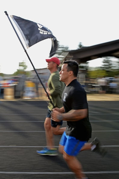 Staff Sgt. Daniel Aguirre, 446th Security Forces Squadron fire team member, run at the McChord outdoor track during the 24-Hour POW/MIA Run Sept. 14, 2017, at Joint Base Lewis-McChord, Wash.