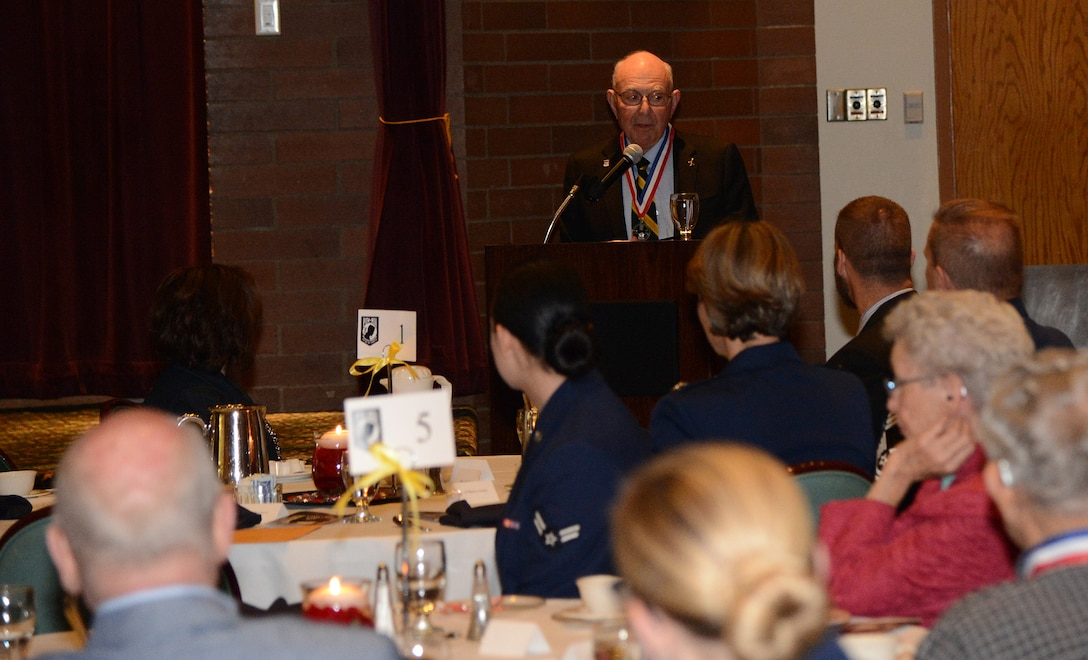 Retired Maj. Joseph Crecca, former prisoner of war and guest speaker, tells his POW story to attendees of the POW/MIA Remeberance Day Luncheon Sept. 15, 2017, at Joint Base Lewis-McChord, Wash.