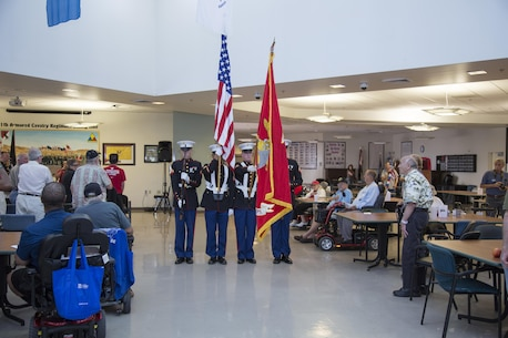 The Walking Color Guard from Marine Corps Logistics Base Barstow, Calif., presents the colors during the Pledge of Allegiance led by Teresa Rochester, Public Information Officer, Veterans Home of California Barstow, during the POW/MIA Recognition Ceremony, Sept. 15.
