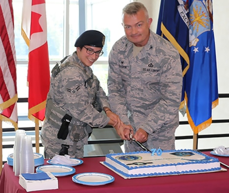 EADS CC and Youngest Airmen Cut Birthday Cake