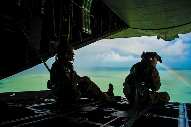 California Air National guardsman, Master Sgt. Eric Valdez,  MC-130P Combat Shadow aircraft loadmaster, looks out across the clear water of Florida's Key region during a reconnaissance and refueling mission supporting search and rescue efforts following hurricane Irma, September 11, 2017.  (U.S. Air National Guard photo by Tech. Sgt. Joseph Prouse/released)