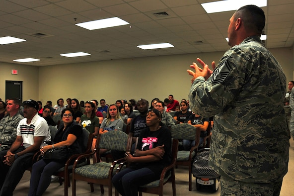 U.S. Air Force Senior Master Sgt. Anthony Wolfe, 20th Security Forces Squadron operations superintendent, speaks to Team Shaw members during a base housing resident town hall at Shaw Air Force Base, S.C., Sept. 7, 2017. Wolfe spoke about increased patrols in the housing area, precautions families can take to deter criminals and the proper reporting of incidents on base. (U.S. Air Force photo by Airman 1st Class Kathryn R.C. Reaves)