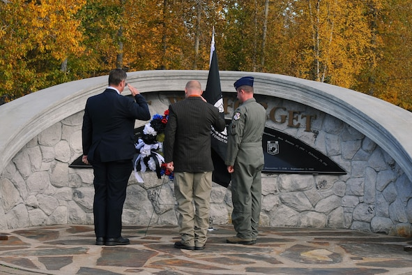 Walter Crary, left, Bryan Hinton and U.S. Air Force Col. Todd Robbins, right, 354th Fighter Wing vice commander, salute a wreath during a POW/MIA ceremony Sept. 15, 2017, at Eielson Air Force Base, Alaska. The wreath symbolizes remembrance of all prisoners of war and missing in action military member's sacrifice. (U.S. Air Force photo by Airman 1st Class Eric M. Fisher)