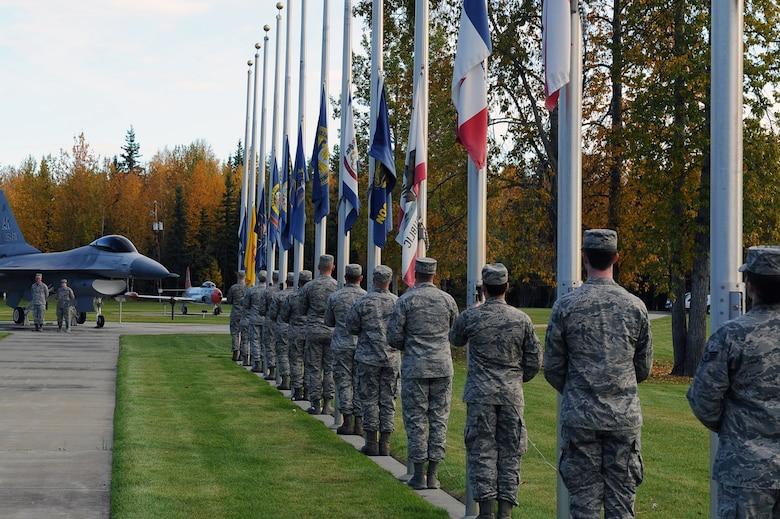 U.S. Air Force Airmen from the 354th Fighter Wing lower state flags during a POW/MIA Ceremony Sept. 15, 2017 at Eielson Air Force Base, Alaska. POW/MIA Recognition day is typically recognized on the third Friday of September every year. (U.S. Air Force photo by Airman 1st Class Eric M. Fishe