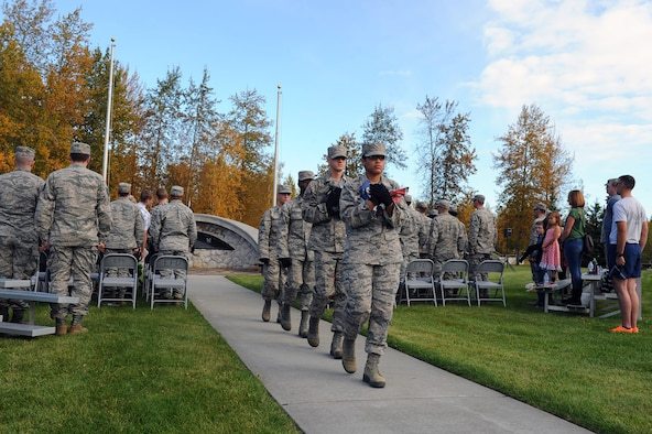 U.S. Air Force Airmen with the 354th Fighter Wing Honor Guard carry the American Flag after retreat Sept. 15, 2017, at Eielson Air Force Base, Alaska. The first POW/MIA Recognition Day was in 1979. (U.S. Air Force photo by Airman 1st Class Eric M. Fisher)