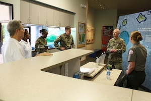 USACE Command Sergeant Major Bradley Houston visited our Pacific Regional Visitor Center at Fort DeRussy in Waikiki Sept. 13, where he met with PRVC Park Ranger Samantha Vazquez and PRVC volunteers.