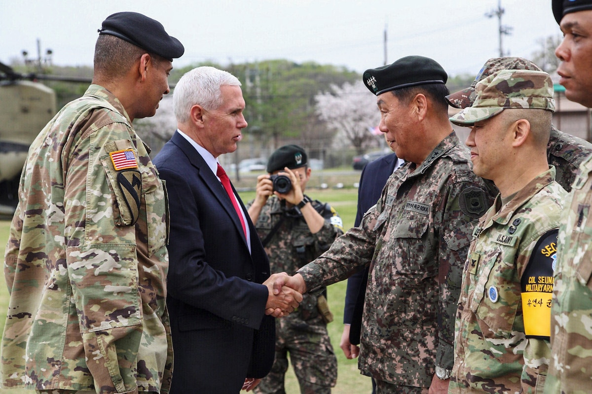 The U.S. vice president shakes hands with a South Korean general.