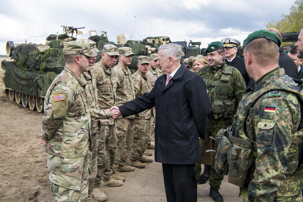 Defense Secretary James N. Mattis shakes hands with a soldier in a line of soldiers.