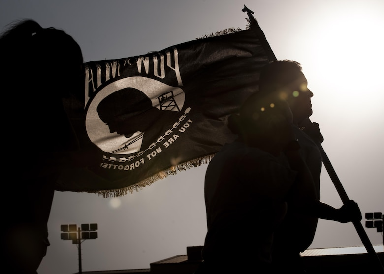 U.S. Air Force Airmen run with the Prisoner of War and Missing in Action flag during the POW/MIA Recognition Day at Kunsan Air Base, Republic of Korea, Sept. 14, 2017. Kunsan Airman and Soldiers participated in a 24-hour run in recognition of POW/MIA service members. This day was established by an Act of Congress, through the passage of Section 1082 of the 1998 Defense Authorization Act and is one of six days that the POW/MIA Flag can be flown.  (U.S. Air Force photo by Staff Sgt. Victoria H. Taylor)