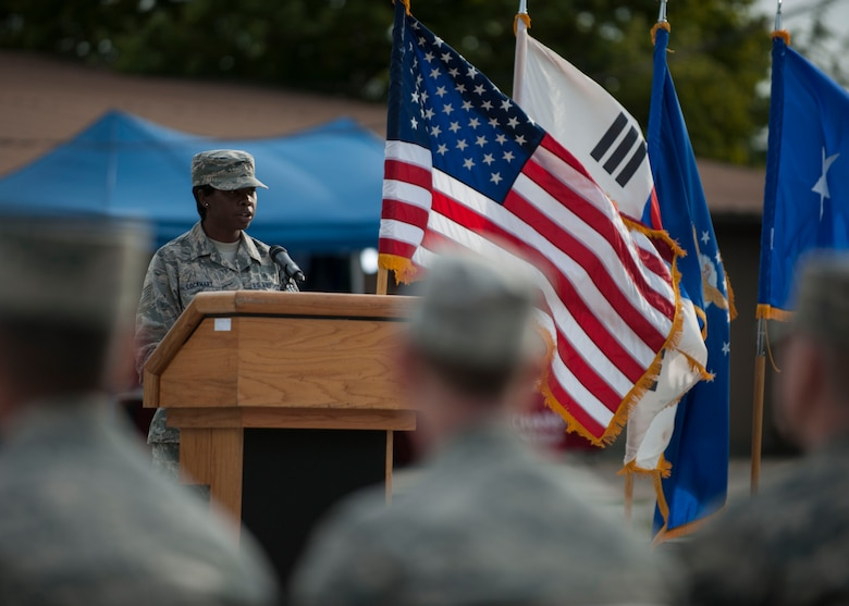 U.S. Air Force Tech. Sgt. Chanute Lockhart, 8th Medical Operations Squadron emergency services tech, speaks during the closing ceremony of the POW/MIA Recognition Day at Kunsan Air Base, Republic of Korea, Sept. 15, 2017. The day was established by an Act of Congress, by the passage of Section 1082 of the 1998 Defense Authorization Act and is one of six days that the POW/MIA Flag can be flown. (U.S. Air Force photo by Staff Sgt. Victoria H. Taylor)
