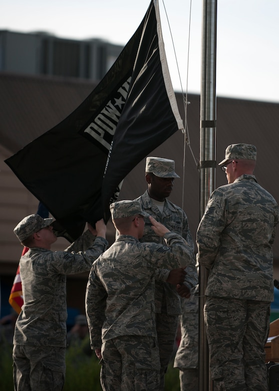U.S. Air Force Airmen perform honor guard duties during the closing ceremony of the POW/MIA Recognition Day at Kunsan Air Base, Republic of Korea, Sept. 15, 2017. In the U.S., the day is observed annually on the third Friday in September to honor those who were prisoners of war and those who are still missing in action. (U.S. Air Force photo by Staff Sgt. Victoria H. Taylor)