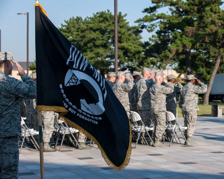 U.S. Air Force Airmen render a salute during the opening ceremony of Prisoner of War and Missing in Action Recognition Day at Kunsan Air Base, Republic of Korea, Sept. 14, 2017. In the U.S., this day is observed annually on the third Friday in September to honor those who were prisoners of war and those who are still missing in action. According to the Defense POW/MIA Accounting Agency, there are still 82,467 Americans still missing from past conflicts dating back to World War II. (U.S. Air Force photo by Staff Sgt. Victoria H. Taylor)