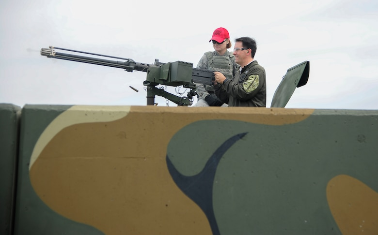 The Honorable Scott Walker, Governor of Wisconsin, fires blanks rounds from a .50 caliber machine gun mounted on a HMMWV during an 8th Security Forces Squadron demonstration at Kunsan Air Base, Republic of Korea, Sept. 16, 2017. Walker visited Wisconsin Air National Guard 115th Fighter Wing Airmen deployed as part of a Theater Security Package and gained a greater understanding of the Wolf Pack's mission. (U.S. Air Force photo by Senior Airman Colby L. Hardin)