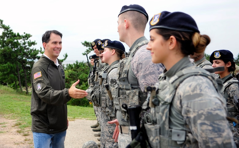 The Honorable Scott Walker, Governor of Wisconsin, greets Airmen from the 8th Security Forces Squadron, at Kunsan Air Base, Republic of Korea, Sept. 16, 2017. Walker visited Wisconsin Air National Guard 115th Fighter Wing Airmen deployed as part of a Theater Security Package and gained a greater understanding of the Wolf Pack's mission. (U.S. Air Force photo by Senior Airman Colby L. Hardin)