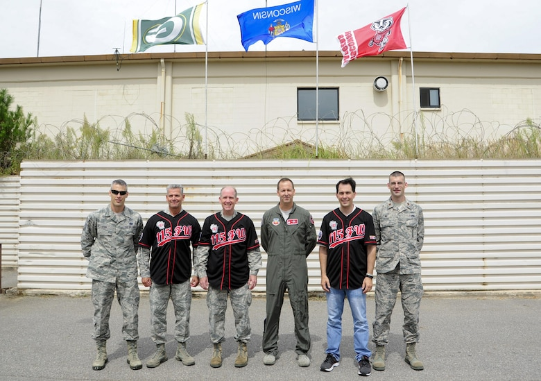 U.S. Air Force Chief Master Sgt. Thomas Safer, 115th Fighter Wing, Wisconsin Air National Guard command chief (left), Maj. Gen. Donald Dunbar, Wisconsin's adjutant general (middle), and The Honorable Scott Walker, Governor of Wisconsin (right), wear traditional Wolf Pack jerseys presented by 115th FW leadership at Kunsan Air Base, Republic of Korea, Sept. 16, 2017. Walker and Wisconsin Air National Guard leadership visited Airmen from the 115th FW deployed to Kunsan for a 4-month rotation as part of a Theater Security Package, which helps to maintain regional security and stability. (U.S. Air Force photo by Senior Airman Colby L. Hardin)