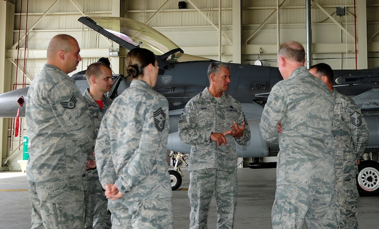 U.S. Air Force Chief Master Sgt. Thomas Safer, 115th Fighter Wing command chief, speaks with a group of Airmen from the 176th Air Expeditionary Maintenance Unit, at Kunsan Air Base, Republic of Korea, Sept. 15, 2017. Safer visited the Airmen who have integrated with the 8th Fighter Wing to defend the base, accept follow-on forces and take the fight north. Airmen from the 115th FW deployed to Kunsan for a 4-month rotation as part of a Theater Security Package. (U.S. Air Force photo by Senior Airman Colby L. Hardin)
